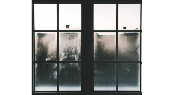 black window frame fogged over