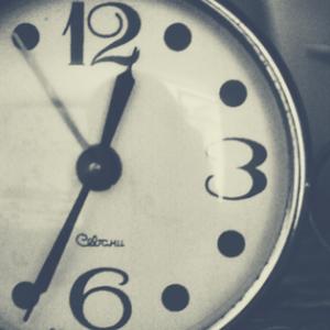 antique clock at 12:35 p.m.
