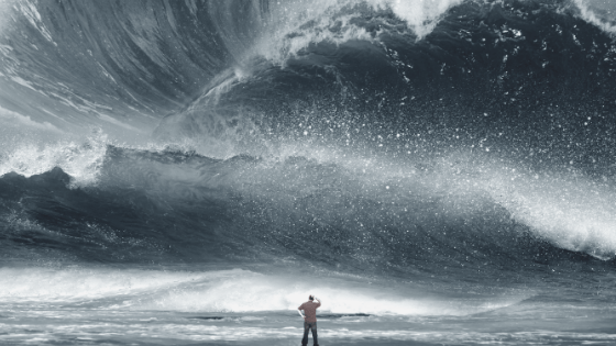 tidal wave looming in front of person scratching his head