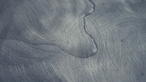 Puddle of water on woodgrain surface