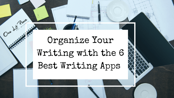 desk with laptop, papers, and sign Organize Your Writing with the 6 Best Writing Apps
