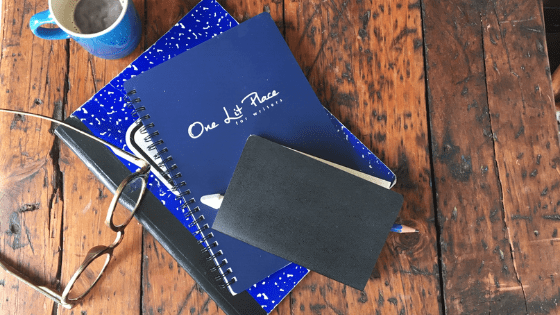 blue notebooks with espresso and glasses