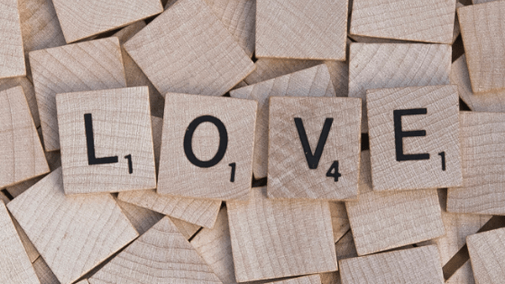 many scrabble blocks with the word LOVE spelled out