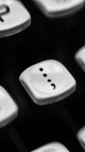 black and white semi-colon computer key