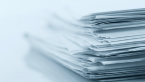 stack of white papers novel editing expert publication support at One Lit Place at onelitplace.com