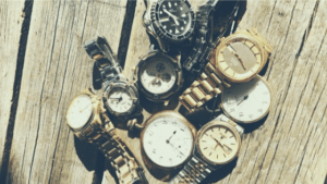 collection of watches on a wooden table