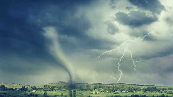 tornado and lightning touching down on village