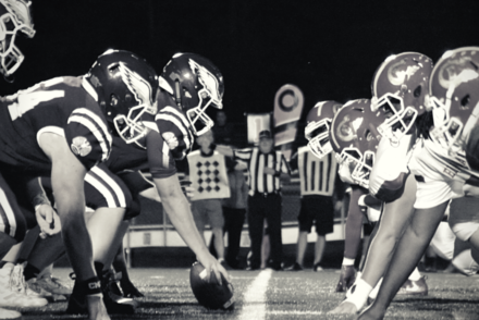 two football teams face off