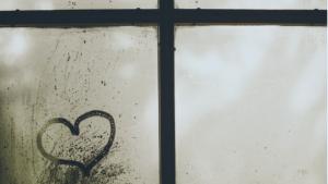heart drawn on fogged-over window