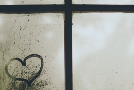 heart drawn on fogged-over window