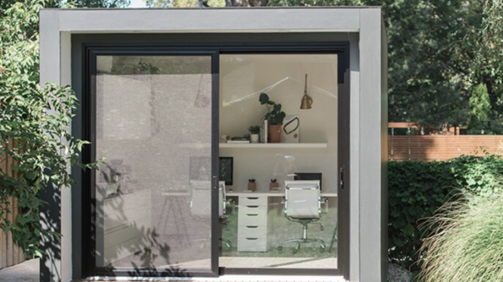 backyard writer's shed with large glass doors